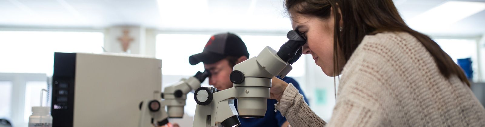 biology lab student with microscope